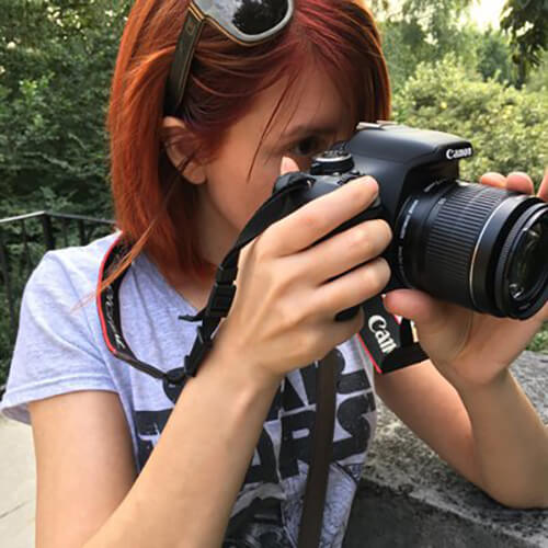 me, a red haired girl holding a camera